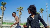 desportivo : Young happy black couple excercising outdoors