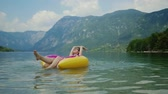 pierscionek : Beautiful woman swimming on inflatable ring in water