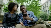 バックパック : Young happy black couple outdoors