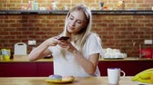 mobile kitchen : Beautiful woman takes picture of her breakfast