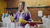cleanness : Young beautiful woman works in kitchen Stock Footage