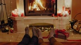 Family in socks near fireplace Стоковые видеозаписи