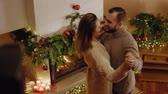 Happy beautiful couple celebrating Christmas