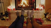 chalet : Family in socks near fireplace Stock Footage