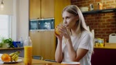 natural drink : Woman eats breakfast