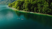 canoe : Top down aerial drone shot of a kayak paddling on a lake