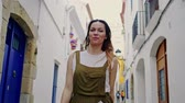 wohnhaus : Woman walking narrow streets of a Sitges, Spain