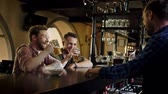 addio al celibato : Cheerful friends drinking draft beer in a pub