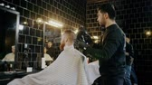 razor shave : Client visiting luxury barber shop Stock Footage