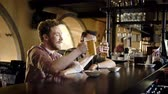 addio al celibato : Cheerful friends drinking draught beer in a pub
