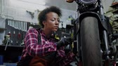 auspuff : African american woman mechanic repairing a motorcycle in a workshop Videos