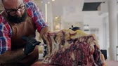 nadir : Chef cutting beef carcass in a restaurant