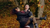 sharp : Lovely couple in autumn park Stock Footage