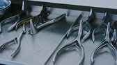 surgical scissors : Medical tools on a table in a hospital Stock Footage