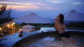 사치 : Young woman sitting in the pool in luxury resort, Bali, Indonesia 무비클립