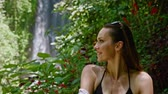 deštivý : Woman enjoying day near Labuhan Kebo Waterfall located in Munduk, Bali Dostupné videozáznamy