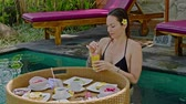 drinkwater : Woman enjoying floating breakfast at Bali