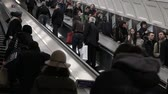 line : LONDON - February, 21: commuters in Londond escalate into underground station Stock Footage