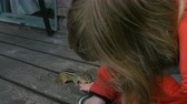 кренделек : A chipmunk eats from a girls hand. Close up. Low angle.