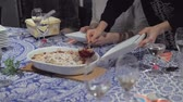 utensílios : Serving a raspberry crumble dessert at a dinner table. Close up. Hands only. Slow motion. Stock Footage