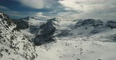 passo : Passo del Tonale Italy. Snow covered mountain peaks filmed from a birde eye perspective. Drone shot.