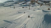 snowboard : A snowboarder performs a jump off a mound in a slope in the Italian Alps. Aerial shot.