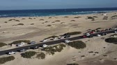 Canary Islands beach panorama. Cars parked on road between sands. Drone view. Dostupné videozáznamy