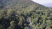 laosz : Kuang Si waterfall and a lush forest seen from high above. Aerial shot.