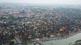 неузнаваемый : Drone shot panorama of historical Hoi An, Vietnam. Birds eye view of cityscape. Drone shot. Стоковые видеозаписи