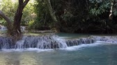 laosz : The famous Kuang Si waterfall in Loas with pools of turquoise colors.