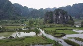 keskeny kilátás : Wetlands in Ninh Binh Vietnam. Karst Mountains in surround the region. Aerial shot. Panorama.