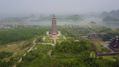 spirál : Bai Dinh pagoda with surrounding landscape. Aerial panorama of the famous religious building. Establishing shot.
