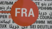 szavak : Fra, Frankfurt, abbreviation behind motivational phrases written in many different languages. Close up. Zoom. Rack Focus. Stock mozgókép