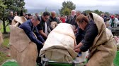 érckoporsó : shot of casket being carry and lower to burial site at cemetery