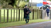 Scottish or Irish bag piper at a funeral service