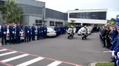 Shot of a funeral with police, dogs, motocycles & helicopter as guard of honor