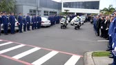 vynucení : Shot of a funeral with police, dogs, motocycles & helicopter as guard of honor