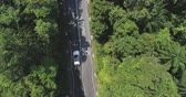 sunny side up : Aerial footage Car rides on the tropical road top view