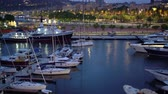 sailboat : yachts in the seaport of Barcelona at night in summer, aerial view.