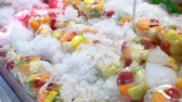 киви : Fresh fruits.Slices of fresh fruits top view on ice