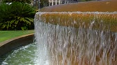 boso : concrete frame of a city fountain with water on a hot day, close up