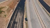 путь : highway extension works. Construction of additional lanes on highway, drone view