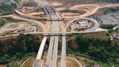 путь : Aerial view of wide highway with a big roundabout and a bridge