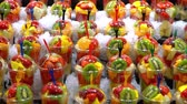 banan : fruit smoothies in glasses in ice on the market. colorful fruits in ice