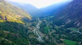 Valley between the mountains with a mountain river. view from the drone