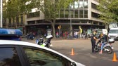 demonstrar : police blocked traffic on street in Barcelona during reconstruction after a riot