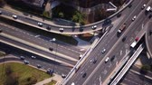 congestionamento : Aerial high drone flight over road traffic. Highway and overpass with cars and trucks, interchange, Following traffic jam. 4K