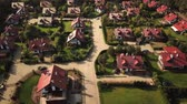 konak : Aerial view from low-flying airplane of residential estates in wealthy neighborhood on a hill. 4k