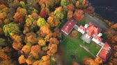 cavaleiro : Flying over the beautiful Castle in autumn Forest. Located in landscape park with green trees forests in autumn. 4K Aerial View.