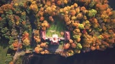 cavaleiro : AERIAL front view of Castle. Flight over beautiful castle, located in landscape park with green trees forests in autumn. 4K